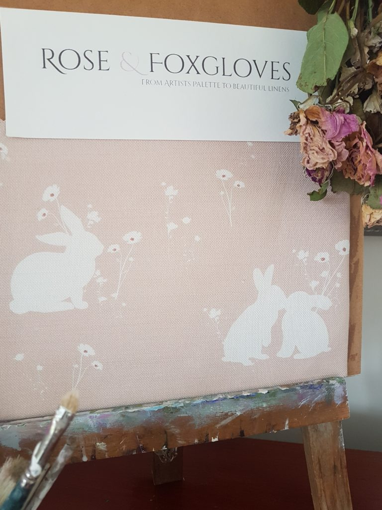 Meadow Rabbits in Pink Linen Fabric.