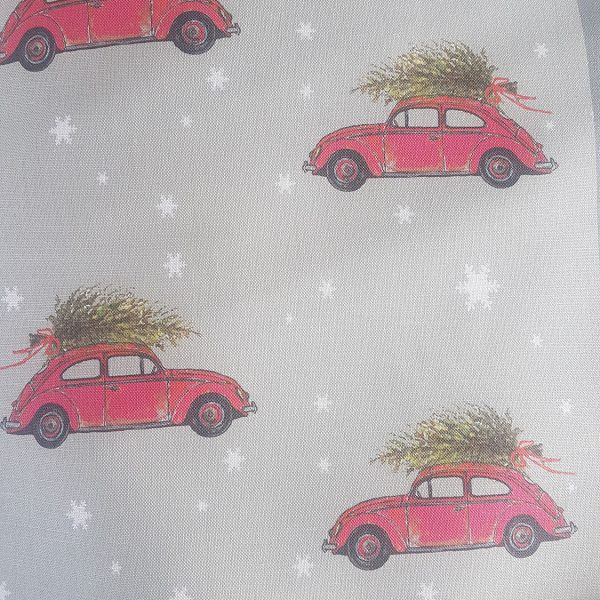 Bringing Home the Tree VW with christmas tree on roof grey linen