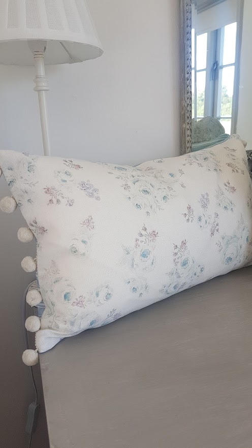 Roses By The Brook Faded Floral Bolster Cushion with Ivory PomPom trim