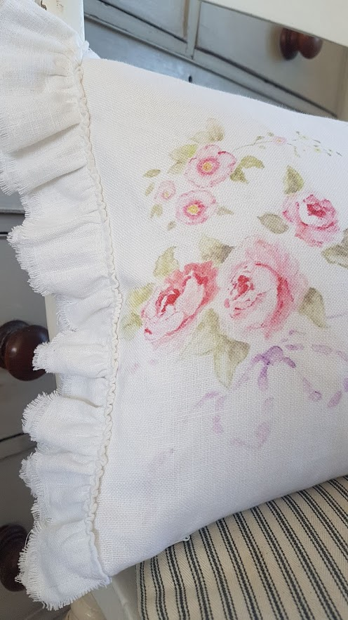 White linen raw edge ruffle rose and bows bolster cushion by rose and foxgloves