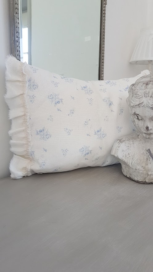 faded french blue roses and powder blue striped ripped edge bolster cushion