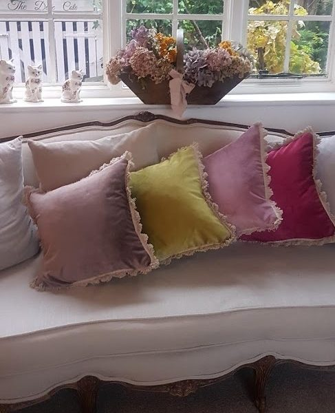 Velvet cushions with Beech Fan Edge trimming Rose & Foxgloves