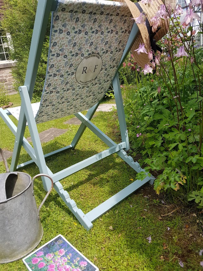 Vintage Meadow Daisies by Rose and Foxgloves on a deckchair